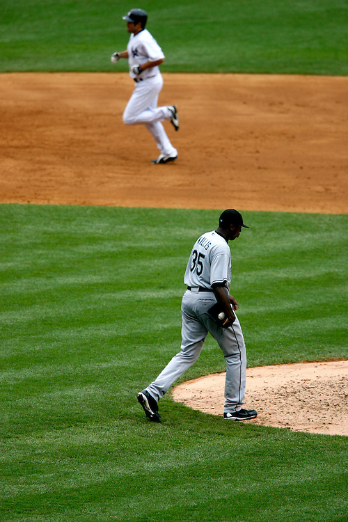 Dontrelle Willis of the Florida Marlins walks back to the mound after giving up a home run to Johnny Damon in the 7th inning at Yankee Stadium, Bronx, New York, Sunday 25 June 2006. (Andrew Gombert for the New York Times)