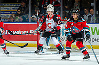 KELOWNA, BC - NOVEMBER 1: Connor Bowie #21 of the Prince George Cougars looks for the pass in front of the net of Roman Basran #30 as Devin Steffler #4 of the Kelowna Rockets looks for the block at Prospera Place on November 1, 2019 in Kelowna, Canada. (Photo by Marissa Baecker/Shoot the Breeze)