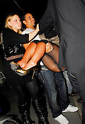 10.MARCH.2007. LONDON<br /> <br /> A VERY DRUNK KIMBERLEY WALSH BEING CARRIED OUT OF EMBASSY CLUB AT 3.00AM IN THE ARMS OF HER BOYFRIEND JUSTIN SCOTT WITH A JACKET OVER HEAD AND THEN BEING PLACED IN THE CAB BY HER BOYFRIEND, SHE MUST HAVE HAD FAR TO MUCH TO DRINK.<br /> <br /> BYLINE: EDBIMAGEARCHIVE.CO.UK<br /> <br /> *THIS IMAGE IS STRICTLY FOR UK NEWSPAPERS AND MAGAZINES ONLY*<br /> *FOR WORLD WIDE SALES AND WEB USE PLEASE CONTACT EDBIMAGEARCHIVE - 0208 954 5968*