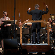 """June 8, 2012 - New York, NY : Conductor David Robertson, standing at right, leads the New York Philharmonic and soprano Charlotte Dobbs, standing at left, in the U.S. premiere of Michael Jarrell's 'NACHLESE Vb: Liederzyklus' (2011) during The Metropolitan Museum of Art's Presentation of """"CONTACT!,"""" the new-music series of the New York Philharmonic, on Friday night. CREDIT: Karsten Moran for The New York Times"""