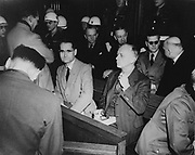 Rudolf Hess (1894–1987) prominent figure in Nazi Germany, acting as Adolf Hitler's deputy in the Nazi Party from 1926-41. Hess (centre in pale jacket) at the War Crimes Trials in Nuremberg, 1946.