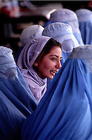 KABUL 25 August 2005..Women watching the Sport event at Ghazi Stadium...On 23-25 August 2005, Special Olympics Afghanistan held its first national Games at Olympic Stadium in Kabul. More than 300 athletes, including 80 female athletes, experienced a taste of happiness and achievement for the first time in their lives. They competed in athletics, bocce and football (soccer). Because of cultural restrictions, males and females competed at separate venues.