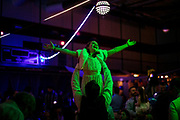 """Jaymes Campbell lifts his daughter Laura, 8, during the refrain to """"Let It Go"""" at a daddy-daughter dance in Spring Hill, Tenn. (The Tennessean)"""