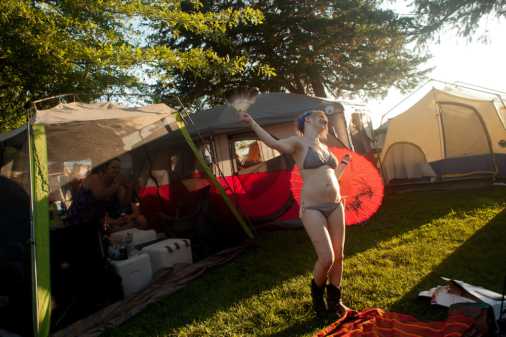 Rachael Stitt poses for a photo at her campsite at Camp Euforia north of Lone Tree on Friday, July 17, 2015.