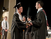 Valedictorian Spencer Goossens is congratulated by Principal J Fitzpatrick as he receives his diploma from Prospect Mountain High School Friday evening.  (Karen Bobotas/for the Laconia Daily Sun)