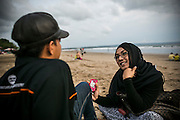 Fiona and her partner have a chat at the double six beach, Bali, Indonesia. The beach has become her favourite place to spend the spare time.