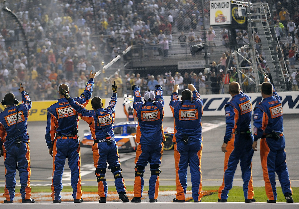RICHMOND, VA - MAY 01:  The crew for Kyle Busch, driver of the #18 NOS Energy Drink Toyota, celebrate after Busch won the NASCAR Nationwide Series Lipton Tea 250 at Richmond International Raceway on May 1, 2009 in Richmond, Virginia.  (Photo by Drew Hallowell/Getty Images)