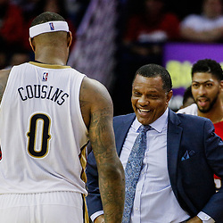 Mar 14, 2017; New Orleans, LA, USA; New Orleans Pelicans head coach Alvin Gentry celebrates with forward DeMarcus Cousins (0) after a basket during the second half of a game against the Portland Trail Blazers at the Smoothie King Center. The Pelicans defeated the Trail Blazers 100-77. Mandatory Credit: Derick E. Hingle-USA TODAY Sports