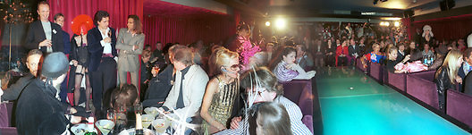 isabella Blow flashing, Johnnie Shand Kydd flashing, Audience at the The Tangueray party in honour of Philip Treacy just before the start of Philip's show.. Pink Paradise Club, Paris. 22 January 2003. © Copyright Photograph by Dafydd Jones 66 Stockwell Park Rd. London SW9 0DA Tel 020 7733 0108 www.dafjones.com