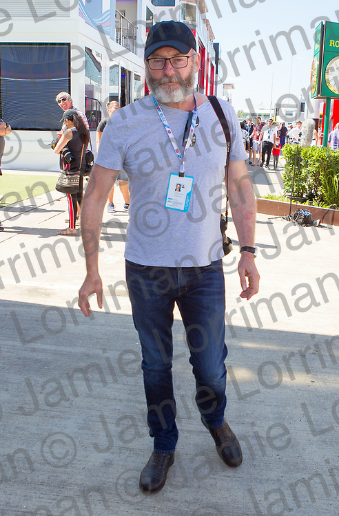 The 2018 Formula 1 F1 Rolex British grand prix, Silverstone, England. Sunday 8th July 2018.<br /> <br /> Pictured: Actor Liam Cunningham (plays Davos Seaworth in Game of Thrones) in the paddock ahead of the race at Silverstone.<br /> <br /> Jamie Lorriman<br /> mail@jamielorriman.co.uk<br /> www.jamielorriman.co.uk<br /> 07718 900288