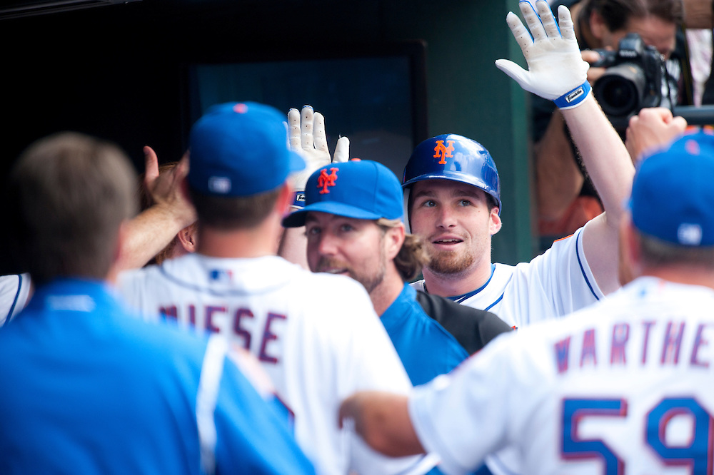 NEW YORK - JULY 16: Daniel Murphy #28 of the New York Mets gets greeted in the dugout by his teammates after hitting a home run  during the game against the Philadelphia Phillies at Citi Field on July 16, 2011 in the Queens borough of Manhattan. (Photo by Rob Tringali) *** Local Caption *** Daniel Murphy