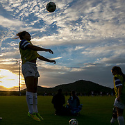 November 14, 2014, Phoenix, Arizona:<br /> A player warms up as the sun sets during an Elite Clubs National League (ECNL) soccer tournament at the Reach 11 Sports Complex in Phoenix, Arizona Friday, November 14, 2014.<br /> (Photo by Billie Weiss/ECNL)