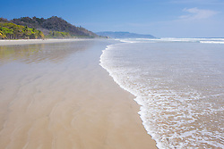 Playa Hermosa wide white sand beach with rolling waves, Costa Rica
