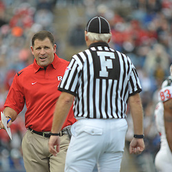 Oct 31, 2009; East Hartford, CT, USA; Rutgers head coach Greg Schiano speaks with a field judge during first half Big East NCAA football action between Rutgers and Connecticut at Rentschler Field.