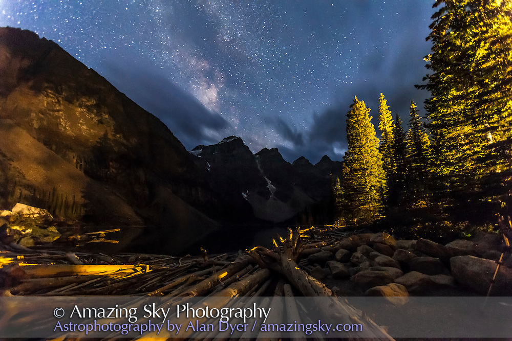 The Milky Way over Moraine Lake and Valley of Ten Peaks, Banff. August 25, 2013. This is one frame from a time-lapse dolly shot, taken at the start of the sequence before moonrise. Lights are from the Lodge lights. This is 30-second exposure at f/2.8 with the 16-35mm lens and Canon 5D MkII at ISO 4000.