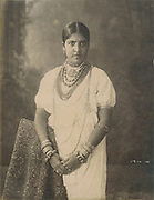 Woman with necklaces.<br /> Archival Black and white photograph.