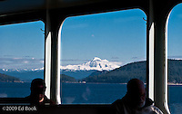 Some folks are jaded to the beautiful scenery of the San Juan Islands with Mount Baker (Koma Kulshan - Great White Watching One) as they ride a ferry between islands - Washington, USA
