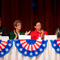 ORLANDO, FL -- October 21, 2010 -- Florida Tea Party candidates Peg Dunmire, left, and Nina Virone clap during a debate at Jones High School in Orlando, Fla., on Thursday, October 21, 2010.