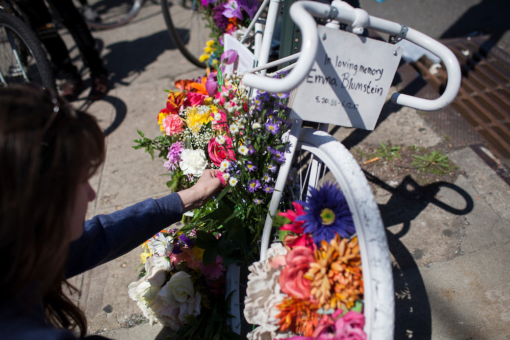 Families and friends of New Yorkers killed while bicycling on New York City streets gather at the Ghost Bike memorial for Emma Blumstein, at the corner of Bedford Ave. and Empire Blvd. in Brooklyn, NY, on Sunday, April 21, 2013 as they participate in the 8th Annual Ghost Bike Memorial Ride. The ride visited the 20 white-painted Ghost Bikes installed at the scene of bicyclist fatalities in five boroughs before converging at the intersection of Queens Boulevard and Jackson Avenue to dedicate a memorial to all of the cyclists who were killed in traffic crashes in 2012 whose deaths did not make the news...According to the New York City Department of Transportation, 136 pedestrians and 18 bicyclists were killed in 2012. In 2011, 134 pedestrians and 22 bicyclists were killed on New York City streets. To date, at least two bicyclists have been killed in 2013...Photograph by Andrew Hinderaker for the Ghost Bike Project.
