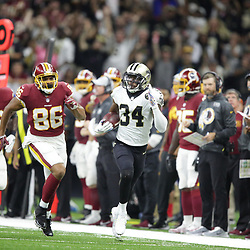 Oct 8, 2018; New Orleans, LA, USA New Orleans Saints cornerback Justin Hardee (34) returns an interception as Washington Redskins tight end Jordan Reed (86) and running back Adrian Peterson (26) pursue during the third quarter at the Mercedes-Benz Superdome. The Saints defeated the Redskins 43-19.