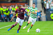 Arnaud Djoum (#10) of Heart of Midlothian holds off Mikael Lustig(#23) of Celtic FC during the Betfred League Cup semi-final match between Heart of Midlothian FC and Celtic FC at the BT Murrayfield Stadium, Edinburgh, Scotland on 28 October 2018.