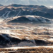 An aerial perspective of a winter temperature inversion within the Jackson Hole valley.