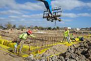Construction crews work on the new Furr High School, December 15, 2015.