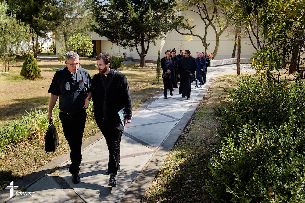 The Rev. Andrew Schlund (right) and the Rev. Daniel Conrad, LCMS missionaries to Mexico, walk together following a talk on Lutheranism given by Conrad at a Catholic Augustinian seminary on Friday, Jan. 13, 2017, in Mexico City.  LCMS Communications/Erik M. Lunsford