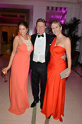 Left to right, LISA SNOWDON, ROD BARKER and TANIA BRYER at the QBF Spring Gala in aid of the Red Cross War Memorial Children's Hospital hosted by Heather Kerzner and Jeanette Calliva at Claridge's, Brook Street, London on 12th May 2015.