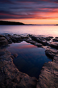 The first light of day is caught by a rock pool along the shoreline of Mt.Desert Island, Acadia National Park, Maine, USA