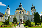 Ettal, Germany - September 02, 2010: Unidentified tourists visit Ettal Abbey, a Benedictine monastery in Ettal, Germany.
