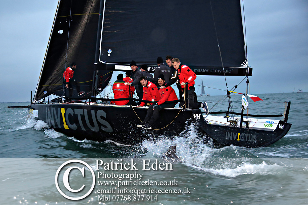 A dolphin sports in the wake of racing yacht Invictus.<br />