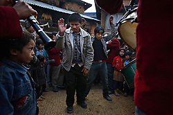 Friends and relatives of bride Sumeena Shreshta Balami, 15, and groom, Prakash Balami, 16, dance in front of the bride's home before the start of the wedding procession in Kagati Village, Kathmandu Valley, Nepal on Jan 24, 2007. The harmful traditional practice of early marriage is common in Nepal. The Kagati village, a Newar community, is most well known for its propensity towards this practice. Many Hindu families believe blessings will come upon them if marry off their girls before their first menstruation.