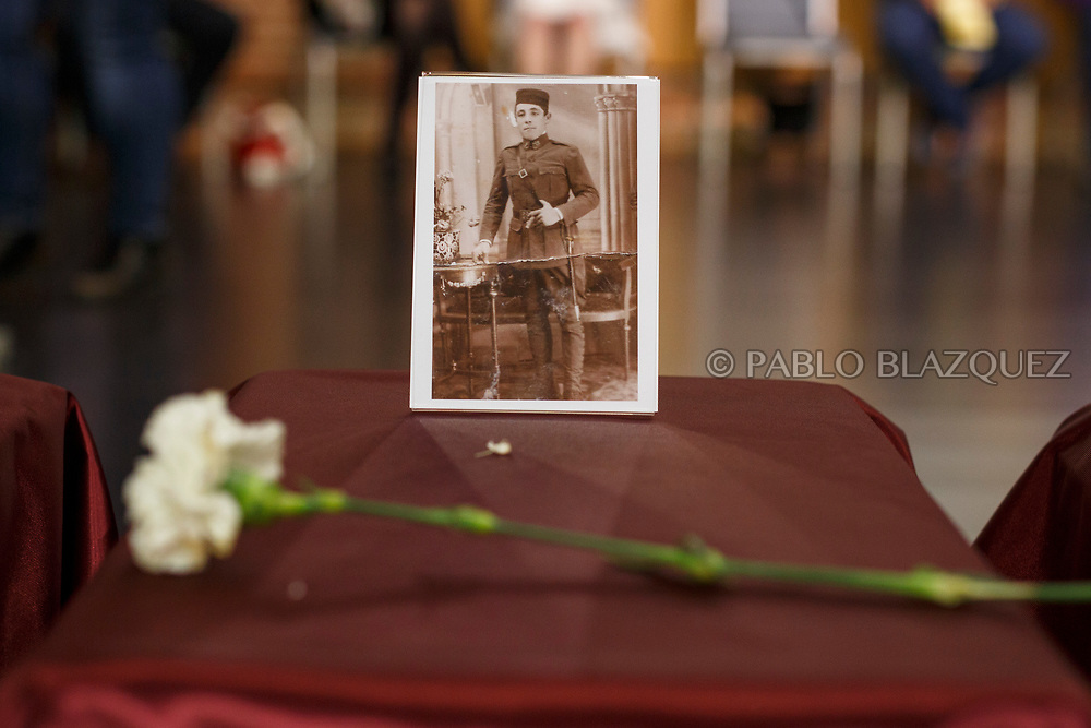 19/05/2018. A picture depicting Alfonso Alonso Agudo stands on top of a box containing his remains during a ceremony to hand the remains of 22 people assassinated by dictator Francisco Franco's forces to their relatives on May 19, 2018 in Guadalajara, Spain. General Franco's forces killed Timoteo Mendieta and other people between 1939 and 1940 after Spain's Civil War and buried them in mass graves in Guadalajara's cemetery. Argentinian judge Maria Servini used the international human rights law and ordered the exhumation and investigation of Mendieta's mass grave. The exhumation was carried out by Association for the Recovery of Historical Memory (ARMH) recovering 50 bodies from 2 mass graves and identified 24 of them. Spain's Civil War took the lives of thousands of people on both sides, but Franco continued his executions after the war has finished. Spanish governments has never done anything to help the victims of the Civil War and Franco's dictatorship while there are still thousands of people missing in mass graves around the country. (© Pablo Blazquez)