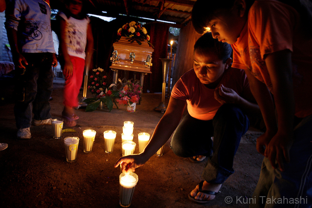 Family members light candles during a vigil for Mariana de la Torre, 29, at the her house in Apatzingan, Mexico on April 8, 2009 in the wake of her death.<br /> (Photo by Kuni Takahashi)