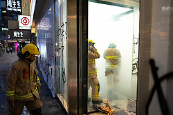 Hong Kong. 6 October 2019. Tens of thousands of pro-democracy protestors march in pouring rain through centre of Hong Kong today from Causeway Bay to Central. Peaceful march later turned violent as a hard-core of protestors confronted police. Pic; Firemen attend Bank of China branch that has been vandalised. Iain Masterton/Alamy Live News.