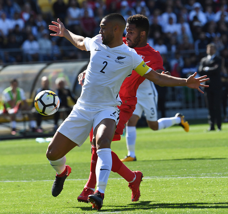 New Zealand's Winston Reid, left, holds back Peru's Jefferson Farfan in the Soccer World Cup qualifying match, Westpac Stadium, Wellington, New Zealand, Saturday, November 11, 2017. Credit:SNPA / Ross Setford  **NO ARCHIVING**