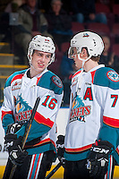 KELOWNA, CANADA - MARCH 1: Kole Lind #16 and Lucas Johansen #7 of the Kelowna Rockets share a laugh on the ice against the Prince George Cougars on MARCH 1, 2017 at Prospera Place in Kelowna, British Columbia, Canada.  (Photo by Marissa Baecker/Shoot the Breeze)  *** Local Caption ***