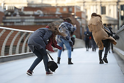 © Licensed to London News Pictures. 23/02/2017. London, UK. Visitors crossing The Millennium  bridge feel the full force of storm Doris. Photo credit: Peter Macdiarmid/LNP