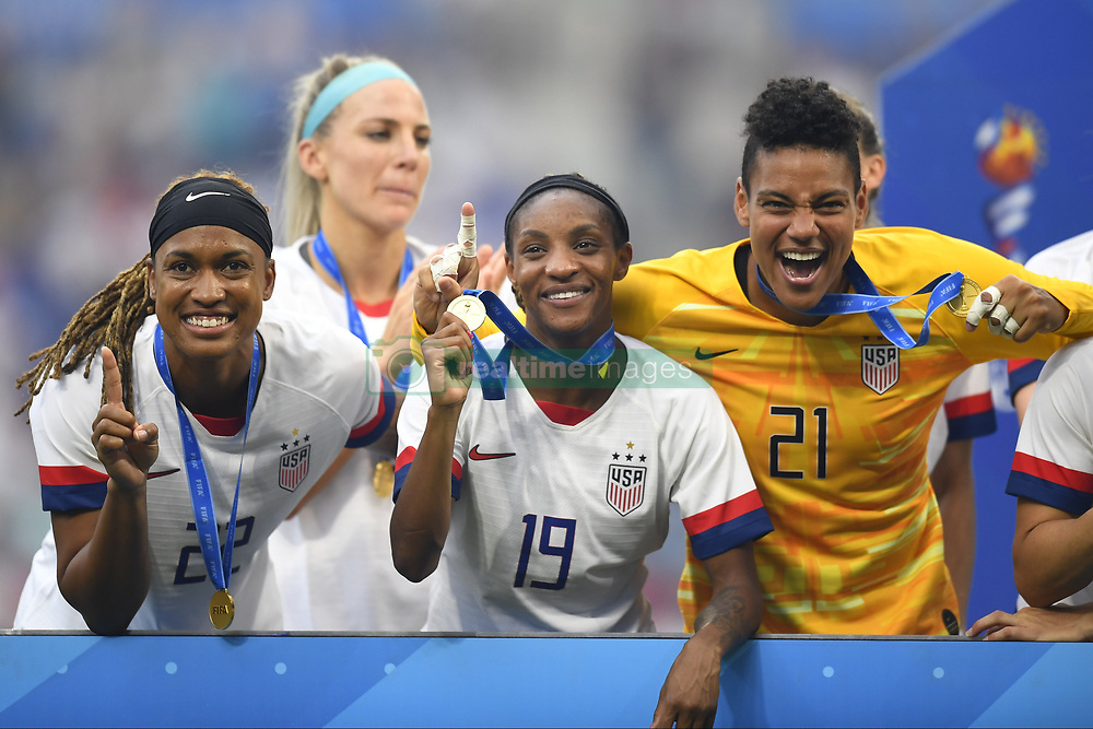 July 7, 2019 - Lyon, France - Jessica Mcdonald (NC Courage), Crystal Dunn (NC Courage) and Adrianna Franch (Portland Thorns FC) of United States celebrate after winning the 2019 FIFA Women's World Cup France Final match between The United State of America and The Netherlands at Stade de Lyon on July 7, 2019 in Lyon, France. (Credit Image: © Jose Breton/NurPhoto via ZUMA Press)