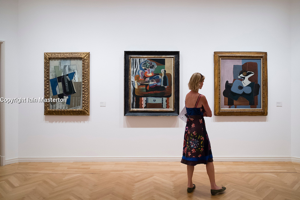 Visitor looking at paintings by Picasso at Berggruen Museum in Berlin Germany