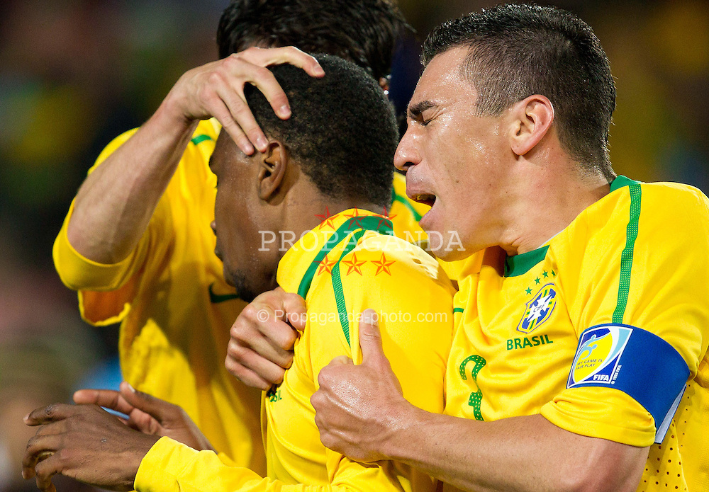 Juan of Brazil and Lucio of Brazil celebrate after Juan scored during the 2010 FIFA World Cup South Africa. EXPA Pictures © 2010, PhotoCredit: EXPA/ Sportida/ Vid Ponikvar +++ Slovenia OUT +++