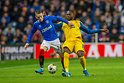 Chancel Mbemba (#19) of FC Porto tackles Ryan Kent (#14) of Rangers FC during the Group G Europa League match between Rangers FC and FC Porto at Ibrox Stadium, Glasgow, Scotland on 7 November 2019.