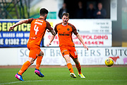 Dundee United midfielder Scott Allardice (#18) leaves the ball to Dundee United defender Mark Durnan (#4) to clear during the Betfred Scottish Cup group stage match between Dundee and Dundee United at Dens Park, Dundee, Scotland on 29 July 2017. Photo by Craig Doyle.
