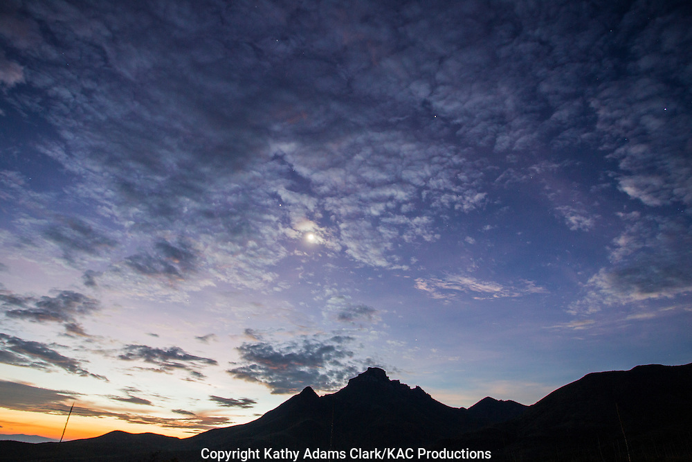 Silhouette of mountains at sunrise in Big Bend National Park, Texas. Vantage point is the Green Gulch parking area.