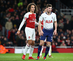 December 19, 2018 - London, England, United Kingdom - London, UK, 19 December, 2018.L-R Matteo Guendouzi of Arsenal and Tottenham Hotspur's Ben Davies.during Carabao Cup Quarter - Final between Arsenal and Tottenham Hotspur  at Emirates stadium , London, England on 19 Dec 2018. (Credit Image: © Action Foto Sport/NurPhoto via ZUMA Press)