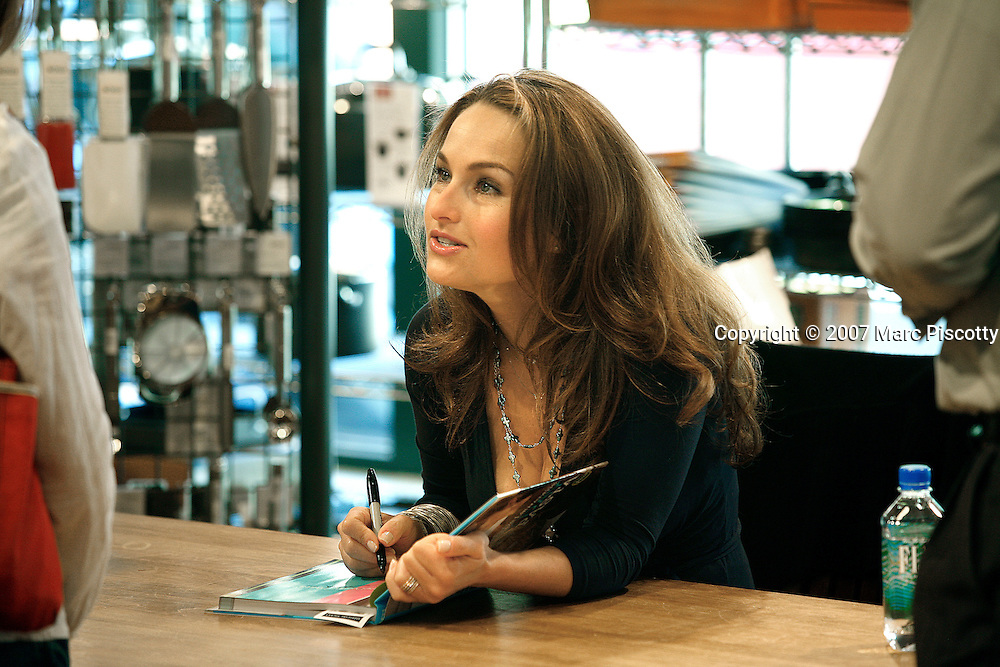 "SHOT 4/13/2007 - Celebrity chef Giada DeLaurentiis signs copies of her new cookbook ""Everyday Pasta"" at the Sur La Table store in Belmar on Saturday April 14, 2007 in Denver, Co. Giada Pamela De Laurentiis (IPA: [?d?ada de lau?rentis]; born August 22, 1970) is an Italian American chef, writer, television personality, and the current host of the Food Network programs Everyday Italian, Behind the Bash, Giada's Weekend Getaways, and Giada in Paradise. She also appears regularly as a contributor and guest co-host on NBC's Today. De Laurentiis is the founder of the catering business GDL Foods.(Photo by Marc Piscotty © 2007)"