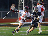 HORSHAM, PA - MARCH 31: Central Bucks East Zach Erwine #30 runs with the ball as Hatboro Horsham's Matt Reamer #24 chases during the second half of a lacrosse game at Hatboro Horsham High School March 31, 2014 in Horsham, Pennsylvania. (Photo by William Thomas Cain/Cain Images)
