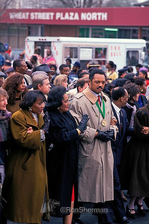 Coretta Scott King marching with Jesse Jackson on Auburn Ave in 1993 ML King Birthday celebration in Atlanta, GA