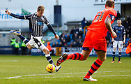 Martyn Woolford of Millwall shoots while David Wheater of Bolton Wanderers looks on during the Sky Bet Championship match at The Den, London<br /> Picture by David Horn/Focus Images Ltd +44 7545 970036<br /> 15/02/2014